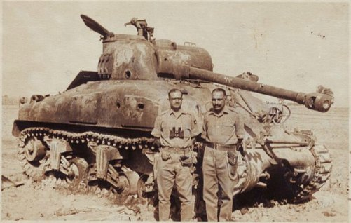This picture was taken after Indian Army destroyed over 100 Patton and Sherman Tanks of Pakistani Army during the 1965 Indo-Pak War. The place was later named as Patton Nagar in Pakistan.