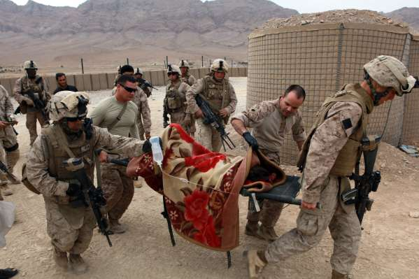 091101-M-8774P-017 HELMAND PROVINCE, Afghanistan (Nov. 1, 2009) Marines and Sailors assigned to India Company, 3rd Battalion, 4th Marine Regiment tend to the medical needs of an injured boy near forward operating base Golestan in Helmand Province, Afghanistan. The boy fell from an unknown height and was in critical condition. (U.S. Marine Corps photo by Lance Cpl. Chad J. Pulliam/Released)
